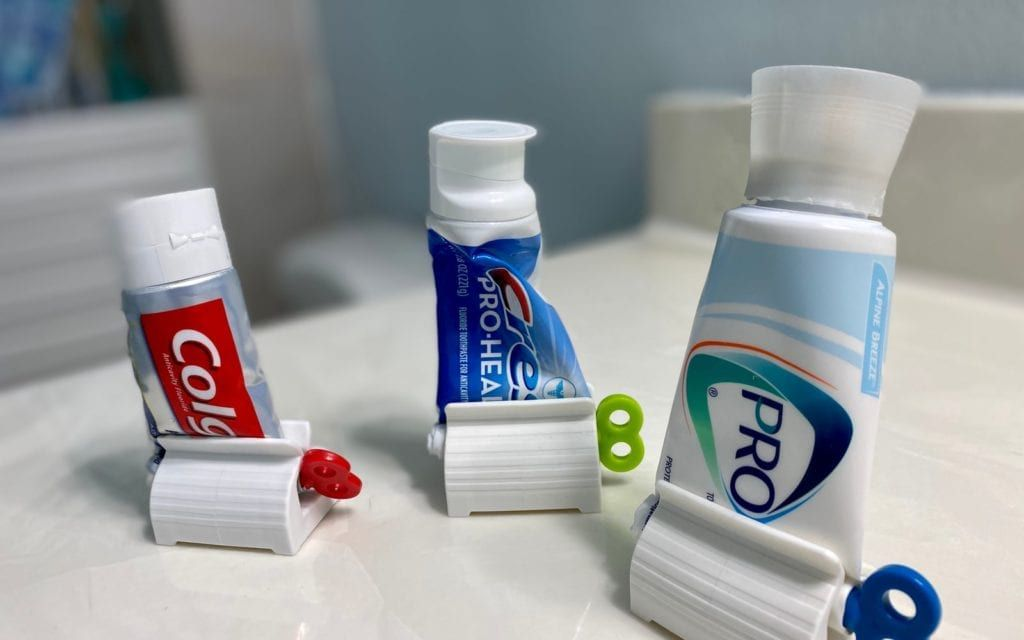 Tubes of Toothpaste Rolled Up and Displayed